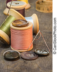 Buttons and needles with sewing thread - Buttons and needles...