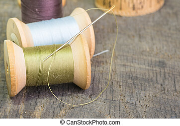 Spools of thread with a needle