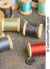 Spools of sewing thread with needle