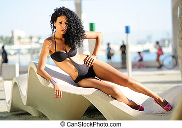 Portrait of a black woman with beautiful body wearing bikini...