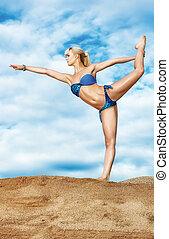 Young slim woman dancing