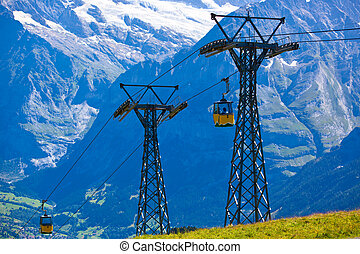 Cableway in Swiss Alps at summer.