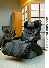black massage chair in spa room