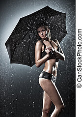 Young sexy woman with umbrella