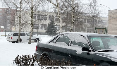 car snow fall winter - cars standing outdoor and snowstorm...