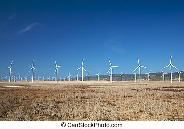 big team of energy mills - energy wind mills at the country...