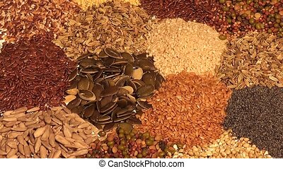 Assortment of edible seeds in small piles including dehusked...