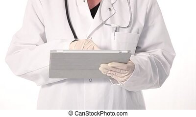 Doctor working on a tablet - Cropped view of the gloved...