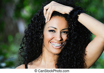 Happy black girl with braces - Portrait of a happy black...