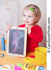 Girl showing her chalkboard drawings - Cute baby girl...