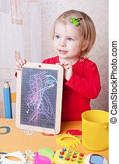 Girl showing her chalkboard drawings - Cute baby girl...