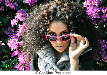 Funny black girl with purple heart glasses