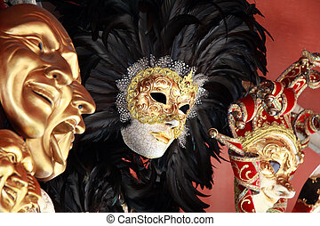 Venetian masks with black feathers on a red background