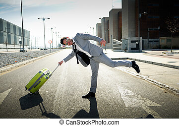 Funny man dressed in suit with a suitcase