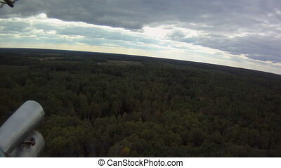 View from window of helicopter - View on forest from...