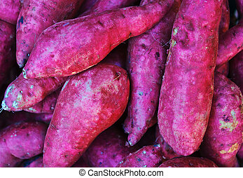 Red sweet potatoes pouring in a wov - Roots grown in India...