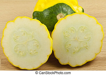 Custard Marrow Squash on cutting bo - Yellow button squash...