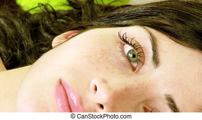 Closeup of beautiful woman thinking