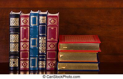 Vintage leather books on mahogany bookshelf