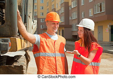 builders works at construction site