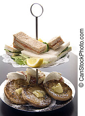 Afternoon tea. - An arrangement of sandwiches and scones for...