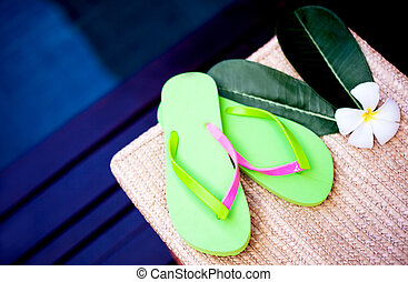 flip flops - Beach flip flops and flower on wicker chair...