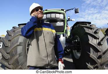 modern farmer with tractor - modern farmer in hardhat with...