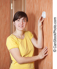 woman turning off the light-switch - Young woman turning off...