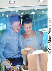 happy young couple in jewelry store - happy young romantic...