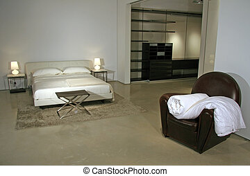 Modern Lifestyle - Interior of a Bedroom in a high end...