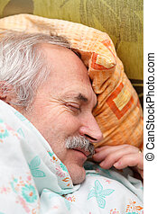 Peaceful Nap - Elderly man laying peacefully in his bed...