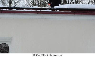 worker drop snow roof