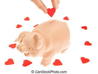 Cute piglet-piggy bank for the collection of hearts. Valentine's Day.