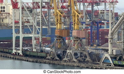 Port cranes unloads cars with coal