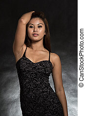 Young and beautiful filipino asian woman in black