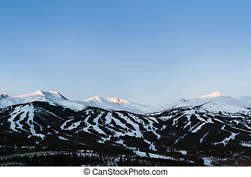 Breckenridge ski area at sunrise in the winter.