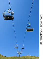 Chairlift - summer chairlift on blue sky background