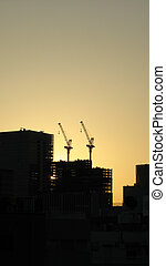 Skyscrapper construction cranes - Two skyscraper...
