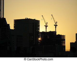 Skyscrapper construction cranes - Two skyscrapper...