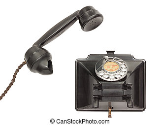 Old Telephone - Old bakelite telephone with the receiver off...