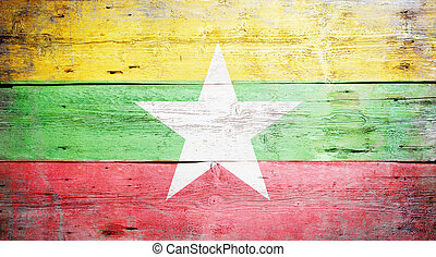 Flag of Burma painted on grungy wood plank background