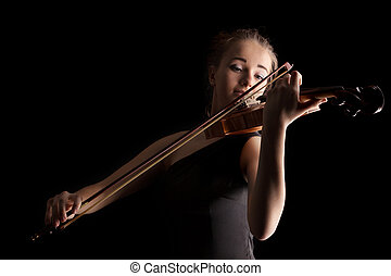 Young woman playing violin on black background