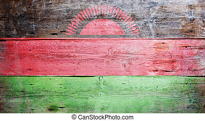 Flag of Malawi painted on grungy wood plank background