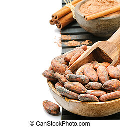 Cocoa beans and powder isolated over white