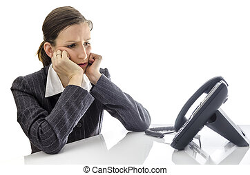 Sad businesswoman waiting for a phone