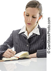 Businesswoman writing in her notepad - Business woman...