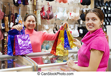 Buyer  and salesman  with purchases at  counter
