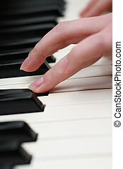 Piano playing - close-up of a Piano-keyboard, very shallow...