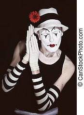 sleep mime in white hat with red flower on a black background