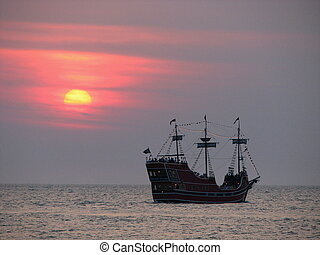 Pirates Sunset - A pirate ship at sunset on the Gulf of...